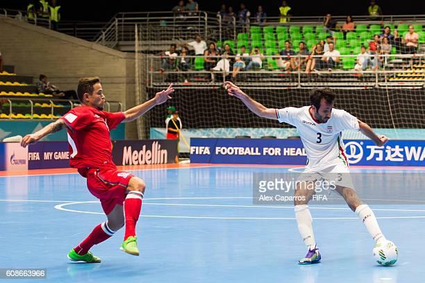 Ahmad Esmaeilpour of Iran shoots the ball next to Vassoura of Azerbaijan during the FIFA Futsal World Cup Group F match between Azerbaijan and Iran...
