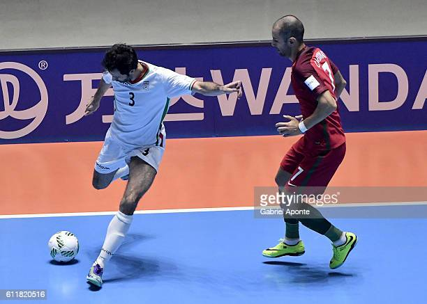 Ahmad Esmaeilpour of Iran struggles for the ball with Cardinal of Portugal during the FIFA Futsal World Cup Third Place Play off match between Iran...