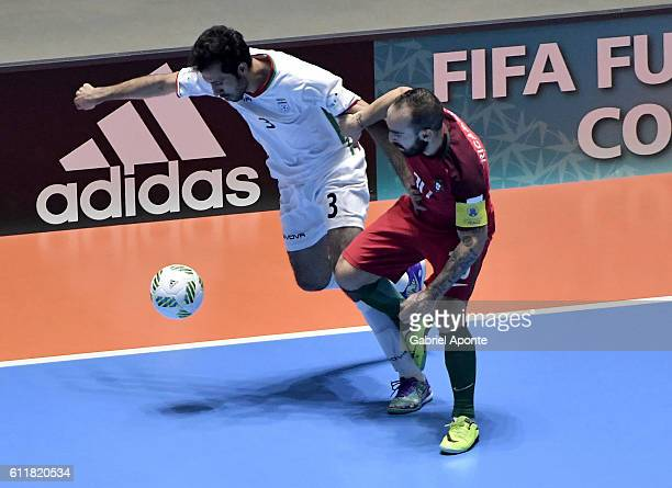 Ahmad Esmaeilpour of Iran struggles for the ball with Ricardinho of Portugal during the final match between Iran and Portugal as part of 2016 FIFA...