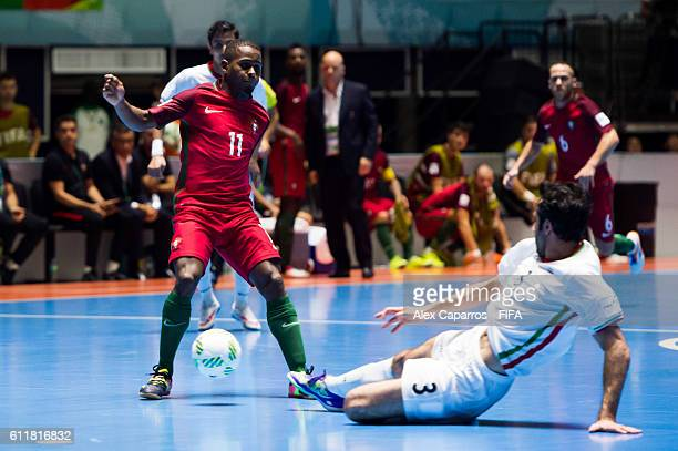 Ahmad Esmaeilpour of Iran tackles Re of Portugal during the FIFA Futsal World Cup Third Place Play off match between Iran and Portugal at the Coliseo...