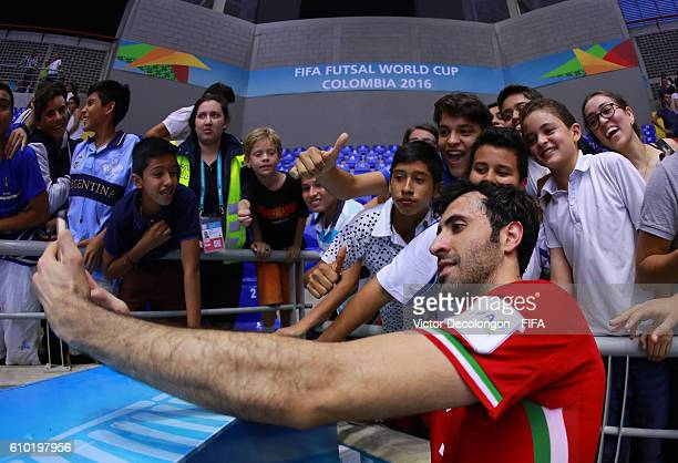 Ahmad Esmaeilpour of Iran takes a selfie photo with a fan after quarterfinal match play between Paraguay and Iran in the 2016 FIFA Futsal World Cup...