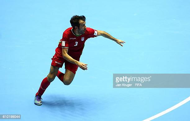 Ahmad Esmaeilpour of Iran turns to celebrate the winning goal in extra time during the FIFA Futsal World Cup quarter final match between Paraguay and...