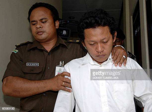 Ahmad Fahrul Rozi accused of killing Australian woman Heidi Murphy is escorted by a prosecutor after his trial at a Denpasar court in Bali island on...