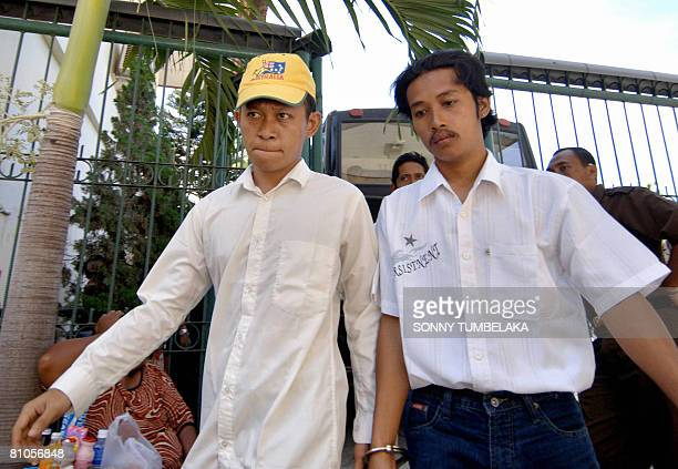Ahmad Fahrul Rozi is escorted by plainclothed police to a court for his trial in Denpasar on Bali island on May 12 2008 Rozi was arrested on February...