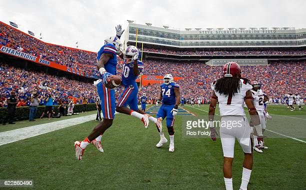 Ahmad Fuelwood of the Florida Gators right celebrates with Josh Hammond after scoring a touchdown during the first half of the game against the South...