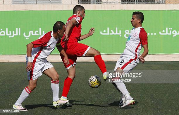 Ahmad Harbi Mahajna of Hebron's Ahly alKhalil fights for the ball with Motaz Majdi of Gaza's Khan Yunis during the second leg of their Palestinian...
