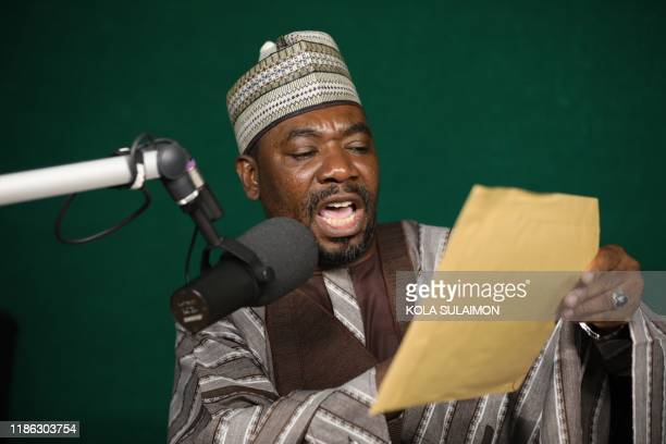 Ahmad Isah speaks during his Isah's Brekete Family radio show, where listeners hope to share their problems over the airwaves in Abuja, on November...
