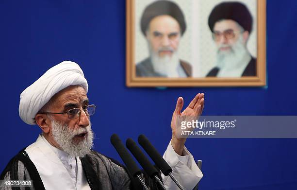 Ahmad Jannati head of Iran's Guardians Council gestures as he delivers his Friday prayers sermon at Tehran University in the Iranian capital on...