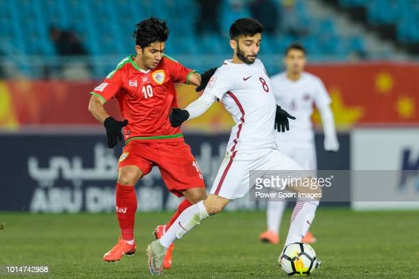 Ahmad Moein of Qatar fights for the ball with Azan Al Tamtami of Oman during the AFC U23 Championship China 2018 Group A match between Oman and Qatar...