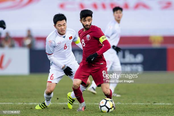 Ahmad Moein of Qatar plays against Luong Xuan Truong of Vietnam during the AFC U23 Championship China 2018 Semi Finals match between Qatar and...