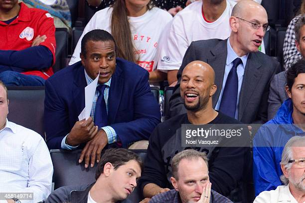 Ahmad Rashad Common and NBA Commissioner Adam Silver attend a basketball game between the Oklahoma City Thunder and the Los Angeles Clippers at...