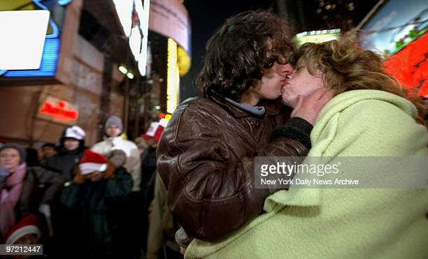 Ahmad Salehi from England and Julia Fox from Buffalo kiss in Times Square while they wait to ring in the New Year
