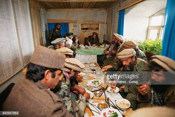Ahmad Shah Massoud eating at his military headquarters in Charikar after the mujahideen have just defeated Mohammad Najibullah's forces in Kabul