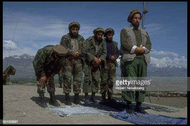 Ahmad Shah Massoud ldr of JamiatiIslami mujahedin rebel forces leading his fighters in prayer