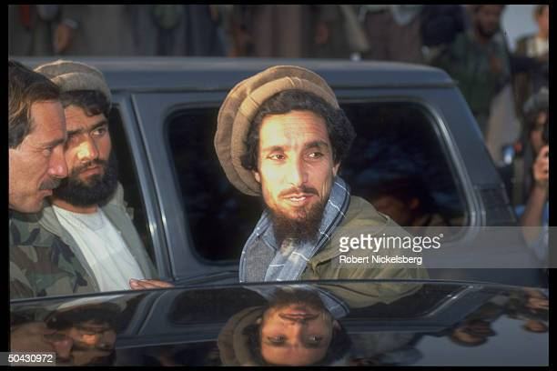 Ahmad Shah Massoud mil ldr of rebel Mujahedin forces by car during mtgs w civil wardefeated Kabul regime army gens