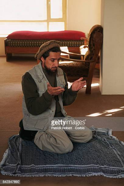 Ahmad Shah Massoud praying near the frontlines to the north of Kabul The city was seized by the Taliban on October 27 1996 | Location North of Kabul...