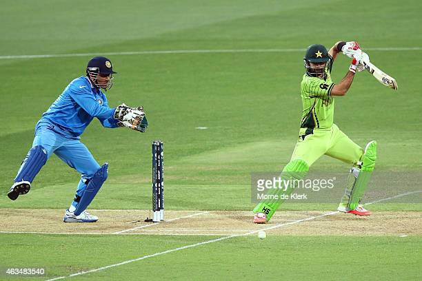 Ahmad Shahzad of Pakistan bats in front of MS Dhoni of India during the 2015 ICC Cricket World Cup match between India and Pakistan at Adelaide Oval...