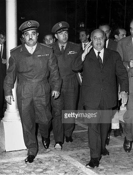 Ahmad Shukeiri also AlShuqeiry or Shukairy the first chairman of the Palestine Liberation Organization walks with General Wagih el Madany commander...