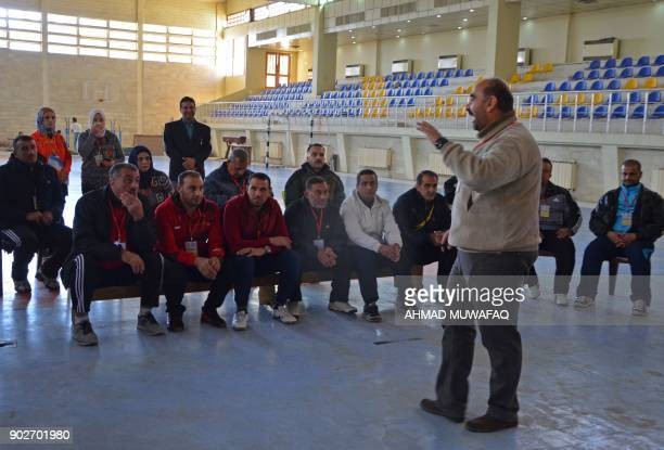 Ahmad Waadallah a professor of psychology leads a training to school teachers on how best to handle students suffering from trauma at a university in...