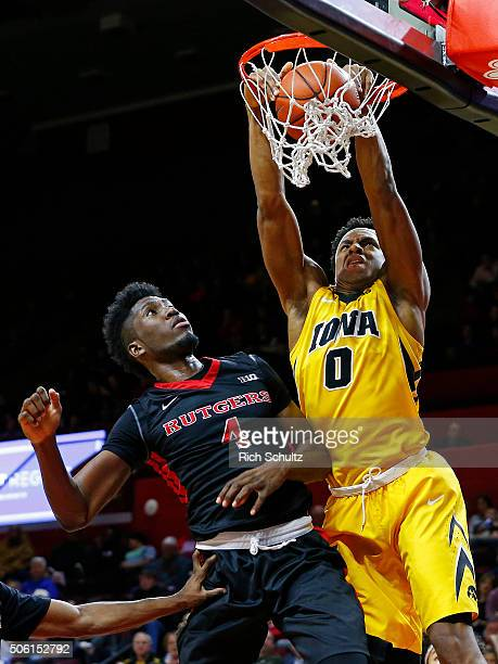 Ahmad Wagner of the Iowa Hawkeyes attempts a dunk as Jonathan Laurent of the Rutgers Scarlet Knights defends during the second half of a college...
