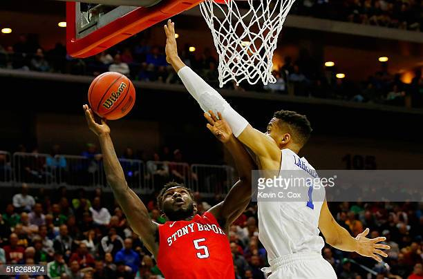 Ahmad Walker of the Stony Brook Seawolves drives against Skal Labissiere of the Kentucky Wildcats in the first half during the first round of the...