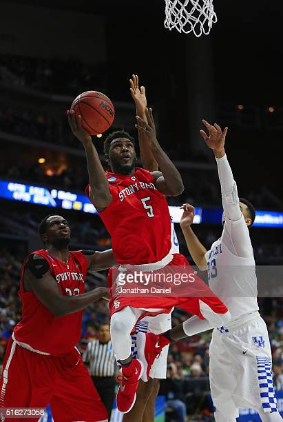 Ahmad Walker of the Stony Brook Seawolves shoots against Jamal Murray of the Kentucky Wildcats in the second half during the first round of the 2016...