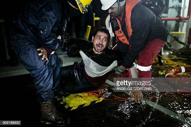 TOPSHOT Ahmad Zarour from Syria reacts after his rescue by MOAS while attempting to reach the Greek island of Agathonisi Dodecanese southeastern...