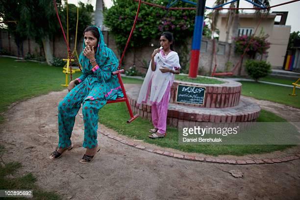 Ahmadi girls play in a playground at the gated Ahmadiyya community July 14 2010 in Chenab Nagar Pakistan The Pakistani Ahmadis define themselves as...