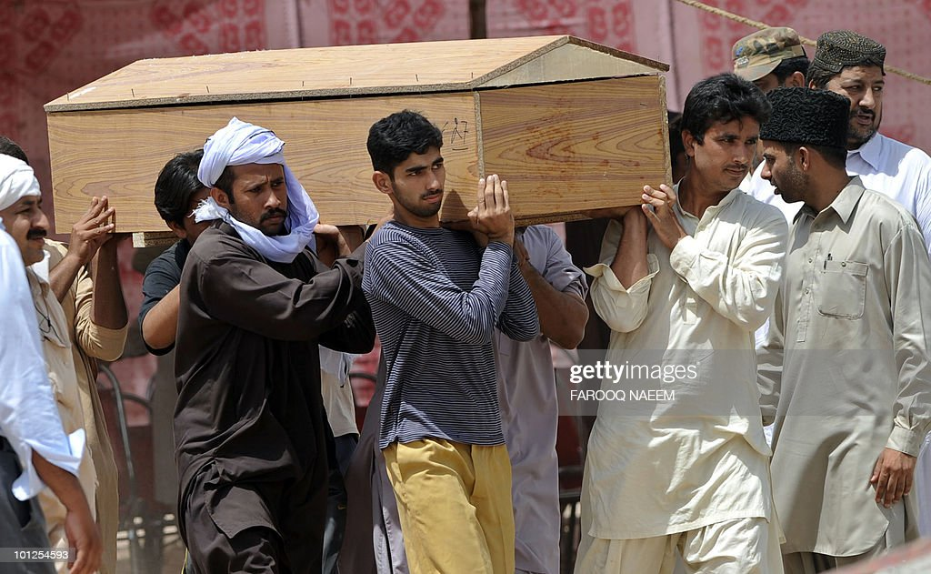 Ahmadi Pakistanis carry the coffin of a victim of yesterday's religious attack at an Ahmadi graveyard in Rabwa on May 29, 2010, a spiritual centre for the Ahmadi community in Pakistan about 160 kilometre west of Lahore. Victims of deadly May 28 attacks on two Pakistani mosques were buried separately after community members cancelled a mass funeral for more than 80 people, fearing further attacks. AFP PHOTO/Farooq NAEEM