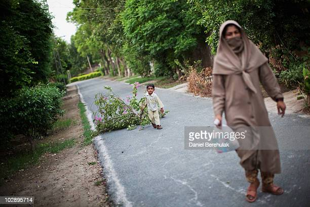 Ahmadi residents gather firewood in the gated Ahmadiyya community July 14 2010 in Chenab Nagar Pakistan The Pakistani Ahmadis define themselves as...