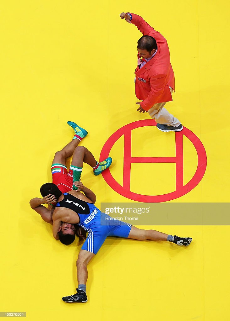 Ahmadjon Mahmudov of Uzbekistan competes with Almat Kebispayev of Kazakhstan in the Men's Greco-Roman 59kg Bronze Medal match during day eleven of the 2014 Asian Games at Dowon Gymnasium on September 30, 2014 in Incheon, South Korea.