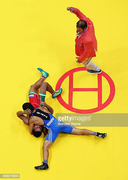 Ahmadjon Mahmudov of Uzbekistan competes with Almat Kebispayev of Kazakhstan in the Men's GrecoRoman 59kg Bronze Medal match during day eleven of the...
