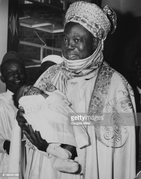 Ahmadu Bello the premier of Northern Nigeria holding 8monthold Siamese twin Joan Adamu at Hammersmith Hospital in London 19th July 1962 Joan who was...
