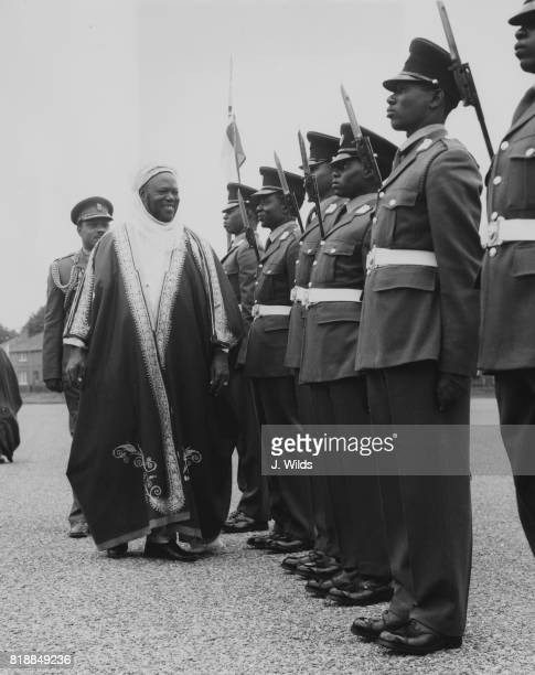Ahmadu Bello the premier of Northern Nigeria inspects Nigerian cadets at the Mons Officer Cadet School in Aldershot during a visit to the UK 17th...