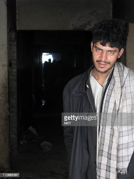 Ahmadullah a 20yearold junkie and former smalltime heroin dealer from Kandahar stands in the doorway of an abandoned building used by opium and...