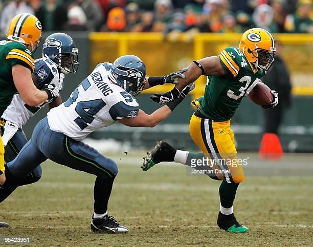 Ahman Green of the Green Bay Packers breaks away from Will Herring of the Seattle Seahawks at Lambeau Field on December 27 2009 in Green Bay...