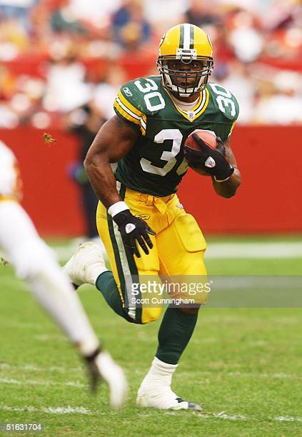 Ahman Green of the Green Bay Packers runs against the Washington Redskins at FedEx Field on October 31 2004 in Landover Maryland The Packers defeated...