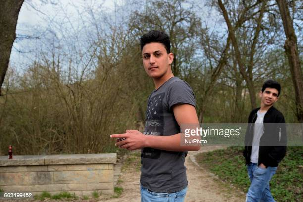 Ahmed 17 years old from Kirkuk Irak enjoying the weekend in the city park of Schwandorf Bavaria on 1st April 2017