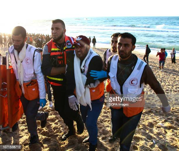 Ahmed Abdel Bari Abu Faul a 35 yearold paramedic who works for the Palestinian Red Crescent Society seen being helped by the medical team after the...