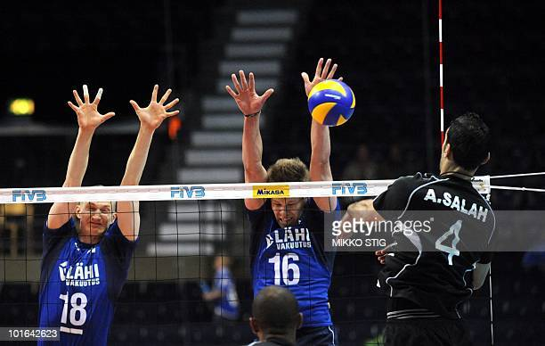 Ahmed Abdelhay of Egypt spikes the ball towards Finland's Jukka Lehtonen and Urpo Sivula during a World League Volleyball match Finland vs Egypt in...