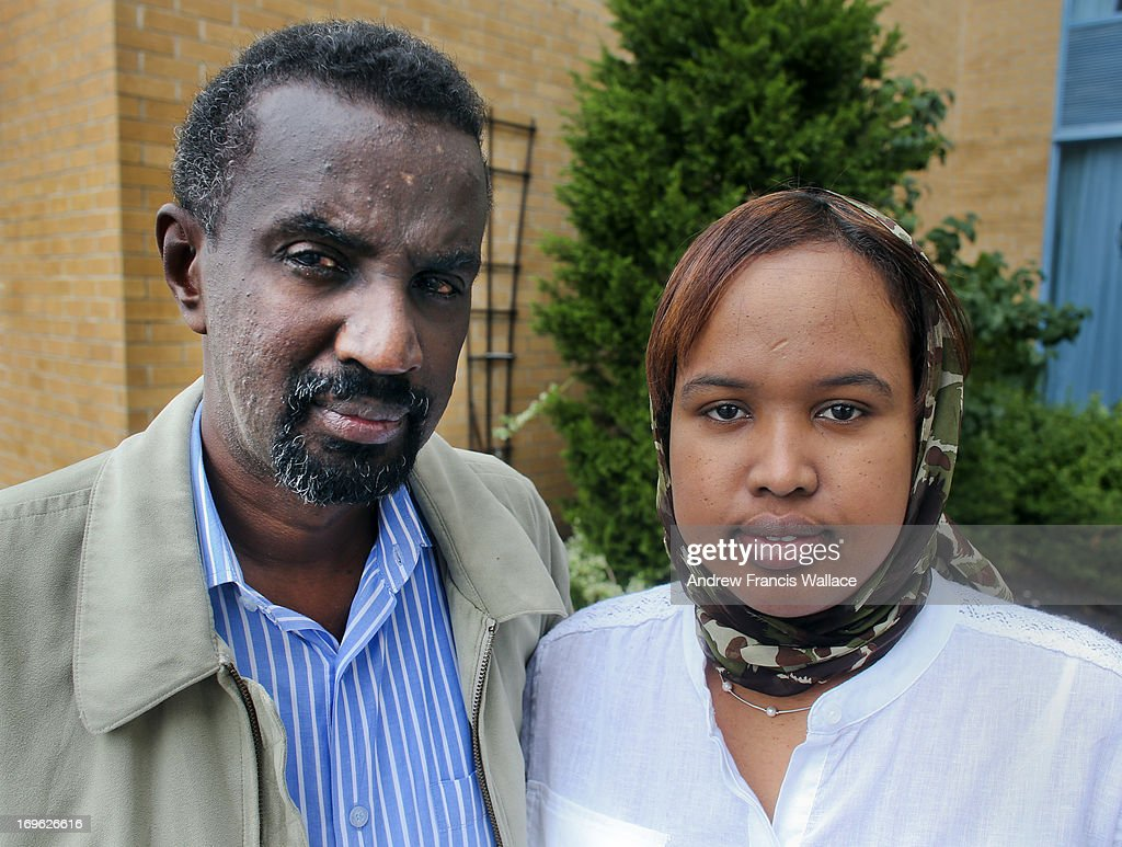 Ahmed Abdisalam Adan And His Wife Pose Outside A Airport Hotel In