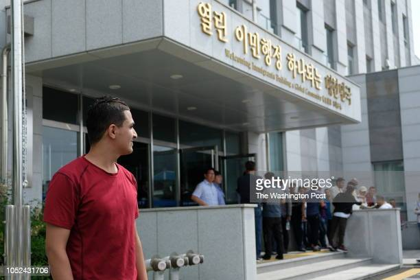 Ahmed Abdu poses for a photo in front of Jeju Immigration Office where he came to attend a job forum on June 19 2018