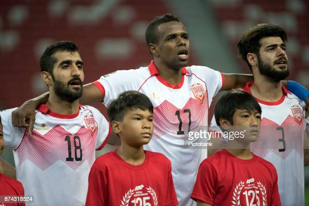 Ahmed Abdulla Ali Abdulla Abubaker Aadem and Waleed Al Hayam of Bahrain during the Asian Cup Qualifier match between Singapore and Bahrain at the...