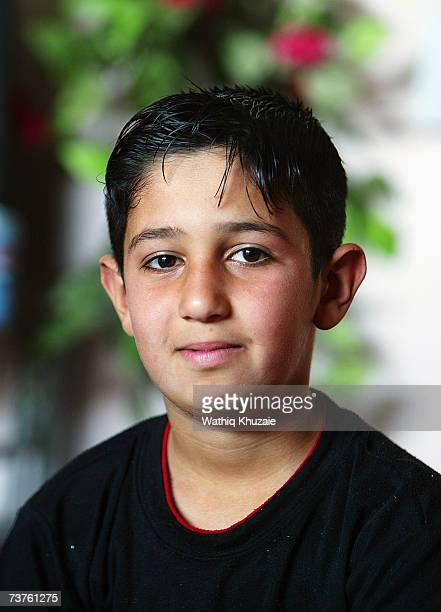 Ahmed age 12 years son of Fuad Mosa Muhammad looks on at his house on March 28 2007 in Baghdad Iraq Fuad a cook at a breakfast and lunch restaurant...