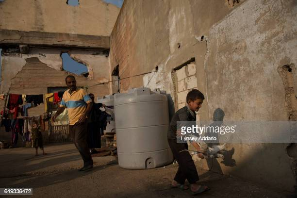 Ahmed Al Khalf from Raqqa Syria plays with his two pigeons in the abandoned factory he and his family are living in in Faida in the Bekaa Valley...