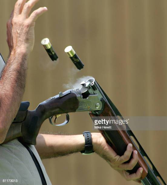 Ahmed Almudhaf of United Arab Emirates discards his spent cartridges during the men's trap finals on August 15 2004 during the Athens 2004 Summer...