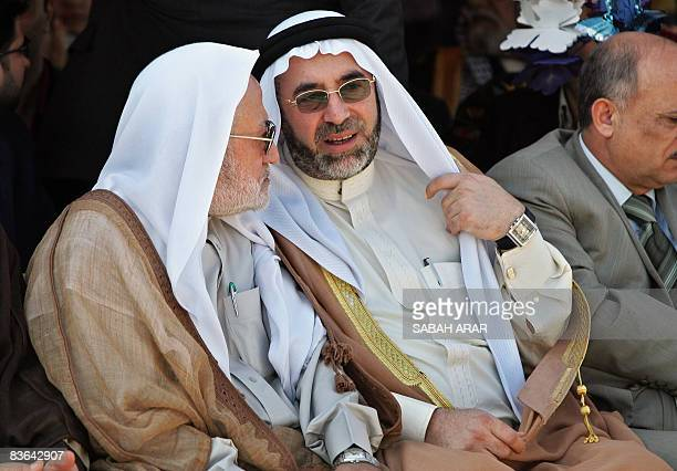 Ahmed alSamarraie the head of Sunni endowments chats with Salih alHaidari the head of Iraq's Shiite religious endowments as they sit on the AlAima...