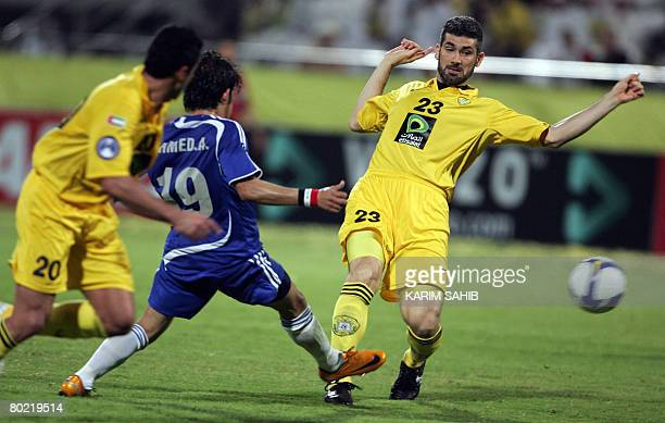Ahmed Anwar of Iraq's AlQuawa AlJawiya club vies with Mohammed alAnezi and Andre Dias of Emirati AlWasl club during their AFC Champions League...