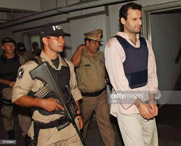 Ahmed Assad Barakat a Paraguayan citizen of Lebanese descent is escorted by policemen at his arrival to the Justice Palace in Asuncion, 18 November...