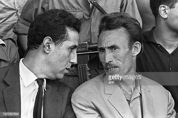 Ahmed Ben Bella speaks to colonel Houari Boumediene at local stadium in Algiers 10 September 1962 Ahmed Ben Bella discute avec Houari Boumediene...